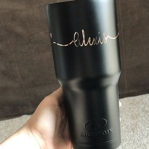 Customized black tumbler with rose goal lettering